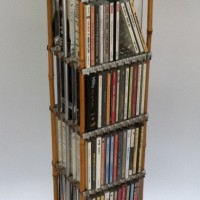 "CD Tower, 1990. metal, plastic, bamboo, found object. 7"" x 7"" x 38"""