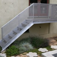Cantilevered Deck/Stairs, 2008, aluminum, fiberglass. Flower Stepping Stones, 2010, concrete.