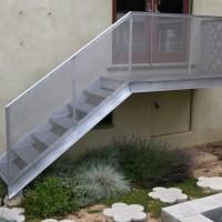 Cantilevered Deck/Stairs, 2008, aluminum, fiberglass. Flower Stepping Stones, 2010, concrete.