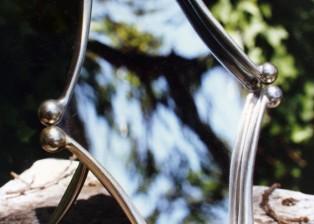 "Mirror, 1990, aluminum motorcycle levers, acrylic. 12"" x 7"" x 8"""