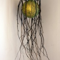 """Hanging Lamp, 1994, mixed media assemblage. 50"""" x15"""". This was the lower section of an Exquisite Corpse sculpture for the """"Fin de Siecle Whirly Gig"""" displayed at FAR BAZAAR at the Brewery in 1994."""