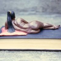 "ODALISQUE 1990 supersculpy, acrylic paint, book. 4""h. 8""w. 6""d."